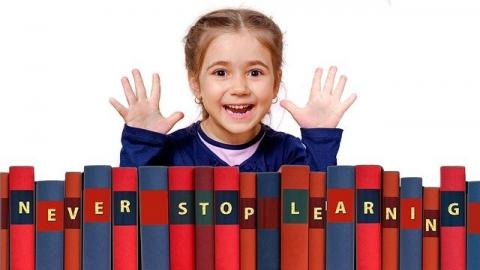Girl with books saying never stop learning